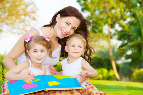 Happy family reading book