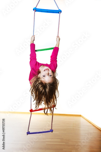 happy little girl climbing on a ladder