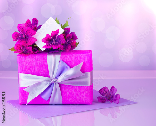 Pink gift box with greeting card