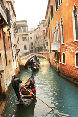 Romantic Venice with gondolas on  canal in Italy