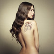 Portrait nude young woman with tattoo