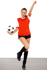 Happy female soccer player