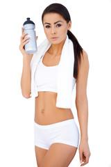 Brunette woman holding water bottle