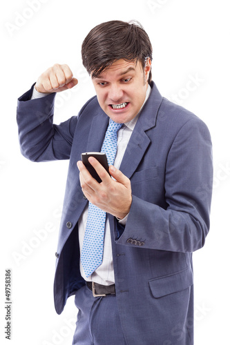 Portrait of a stressed businessman getting bad news by phone