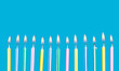 birthday candles in a row with flames