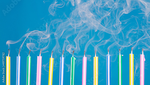birthday candles in a row with smoke