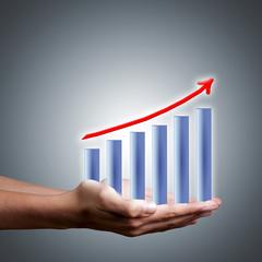 manos y grafica de las finanzas