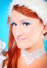 Beautiful ginger in a dress of Snow Queen