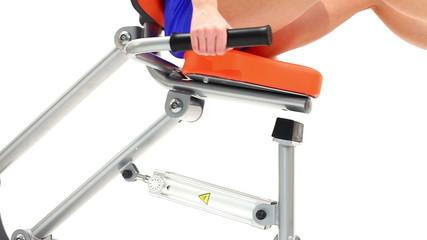 Slim woman's legs on isodynamic trainer close-up