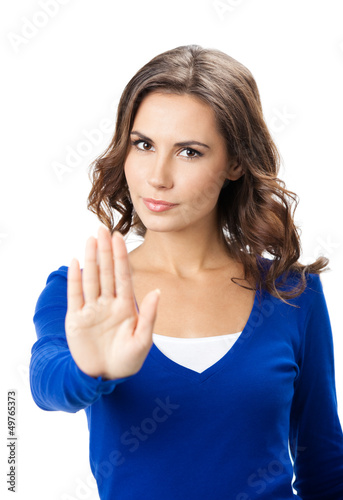 Serious woman with stop gesture, isolated