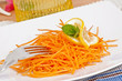 Julienne carrot salad close up in white plate
