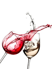 Red and white wine splash from two glasses