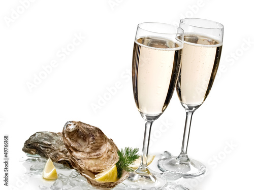 Champagne glasses with two oysters