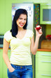 happy woman eating apple, kitchen interior