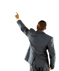 African businessman pointing at wall. rear view.