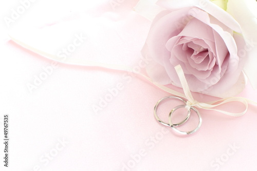 close up of purple rose and pair rings  for wedding image