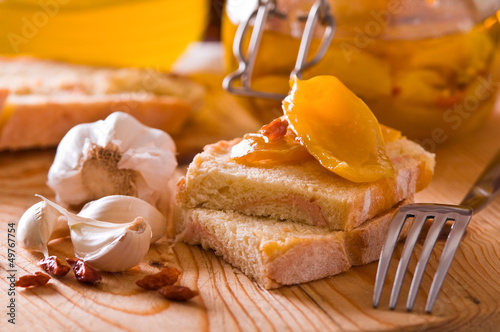 Sliced bread with peppers under oil.