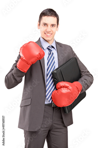 Young businessman with red boxing gloves holding a briefcase