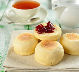Traditional English muffins on a white table