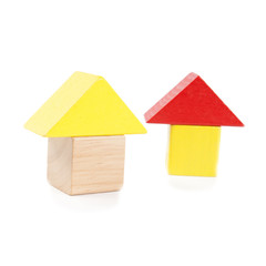 Wooden toy houses isolated on white