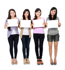 girls holding white board