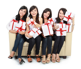 woman group holding gift boxes