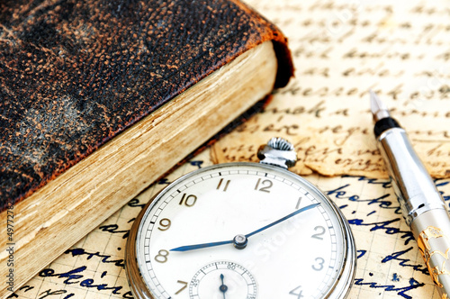 Antique book and pocket watch
