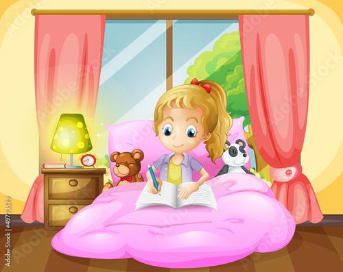 A girl writing inside her room