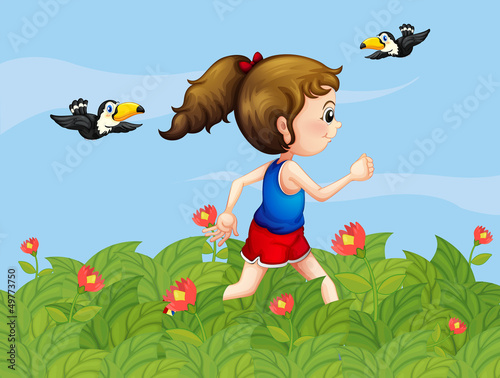 A girl walking at the garden with birds
