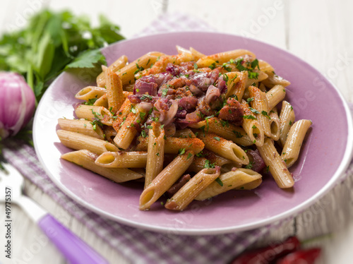 pasta with onions parsley and hot chili pepper, selective focus