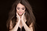 Beautiful woman with long brown hair. Closeup portrait of  fashi