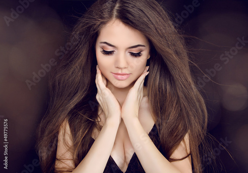 Beautiful woman with long brown hair. Fashion long hairstyles