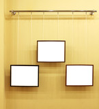 Three frames with isolated canvas on the exhibition ledge