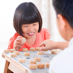 Asian playing Chinese chess
