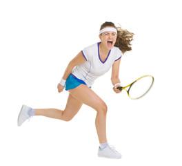 Fierce tennis player hitting ball
