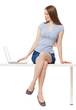 Woman sitting with a laptop