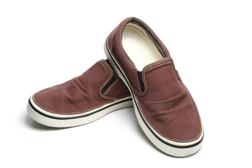 brown slip-on casual shoes over a white background
