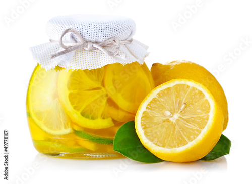 Lemon jam with ripe fruits isolated on white