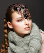 Braided Hair Luxurious Woman in Fur Collar and Gemstones. Jewels