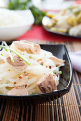 appetizing rice noodles with chunks of tuna