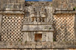 Wall symbol of the god of water chak in Uxmal, Mexico