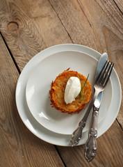 Potato pancake with sour cream