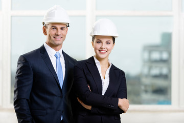 Portrait of two engineers standing near each other