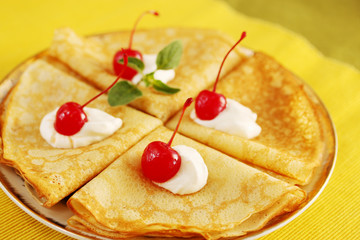 Pancakes and cherries