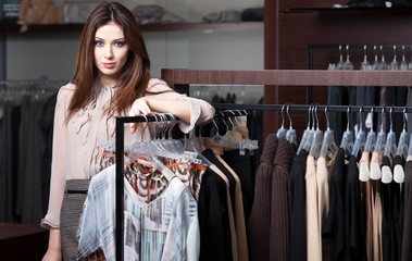 Pretty woman is in the ready-made clothes shop