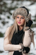 Attractive young woman in a winter fashion shot in park