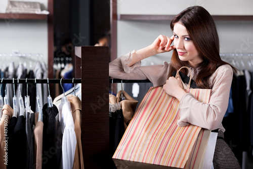 Woman carries paper bags at the shopping center