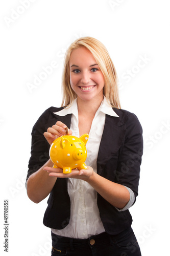 Young woman feeding piggy bank