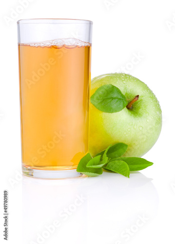 Apple juice in glass and green juicy apple with green leaf on wh
