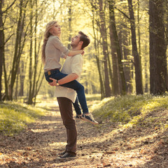 happy young couple have fun in the summer forest